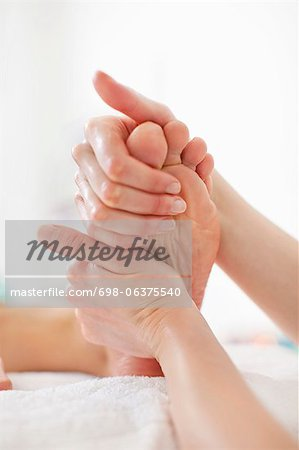 Woman receiving a foot massage at health spa Stock Photo - Premium Royalty-Free, Image code: 698-06375540