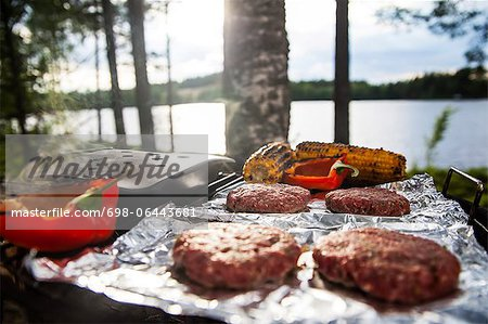 Meat, corn and bell pepper being grilled on barbecue Stock Photo - Premium Royalty-Free, Image code: 698-06443681