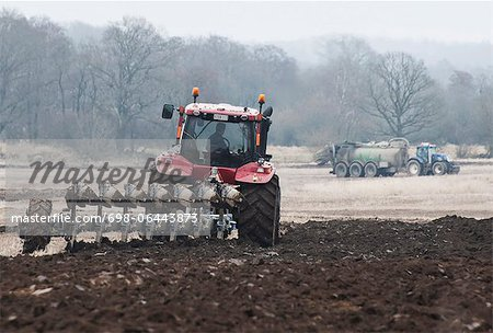 Farmer plowing field in spring Stock Photo - Premium Royalty-Free, Image code: 698-06443873