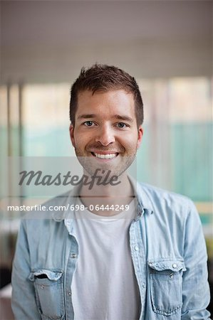 Portrait of happy young Caucasian man smiling Stock Photo - Premium Royalty-Free, Image code: 698-06444249