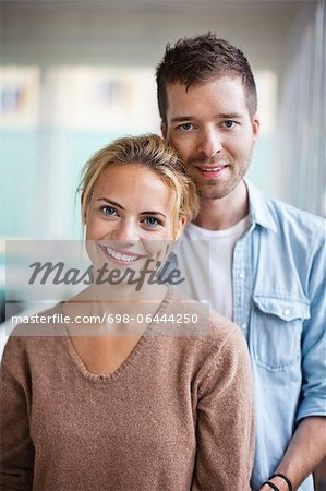 Portrait of happy young Caucasian couple standing together Stock Photo - Premium Royalty-Free, Image code: 698-06444250