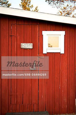 Signboard with text on wooden door Stock Photo - Premium Royalty-Free, Image code: 698-06444269