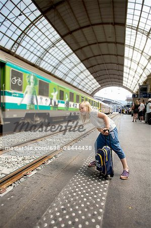 Young girl waiting for train Stock Photo - Premium Royalty-Free, Image code: 698-06444438