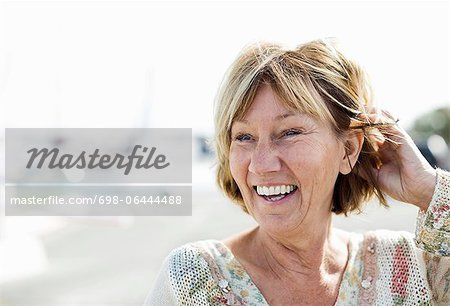 Happy mature woman looking away Stock Photo - Premium Royalty-Free, Image code: 698-06444488