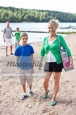Happy Caucasian family spending leisure time on beach Stock Photo - Premium Royalty-Free, Image code: 698-06444508