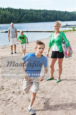 Caucasian family spending leisure time on beach Stock Photo - Premium Royalty-Free, Image code: 698-06444509