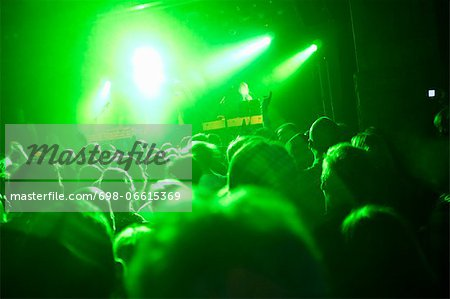 Rays of green lights over crowded dance floor at nightclub Stock Photo - Premium Royalty-Free, Image code: 698-06615369