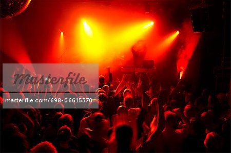 Rays of red spotlights over crowded dance floor at nightclub Stock Photo - Premium Royalty-Free, Image code: 698-06615370