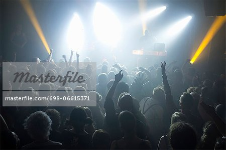 Rays of spotlights over crowded dance floor at disco Stock Photo - Premium Royalty-Free, Image code: 698-06615371