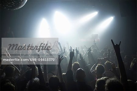Rays of white spotlights over crowded dance floor at nightclub Stock Photo - Premium Royalty-Free, Image code: 698-06615372