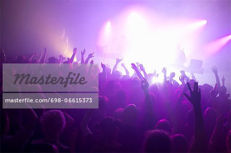 Rays of purple spotlights over crowded dance floor at nightclub Stock Photo - Premium Royalty-Free, Image code: 698-06615373