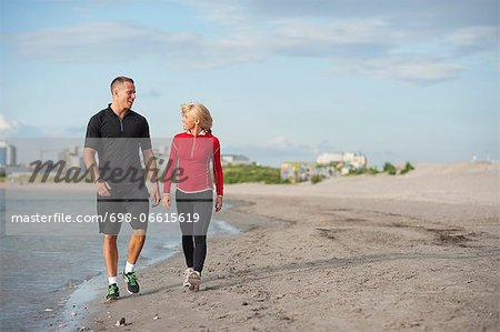 Young friends walking at beach Stock Photo - Premium Royalty-Free, Image code: 698-06615619