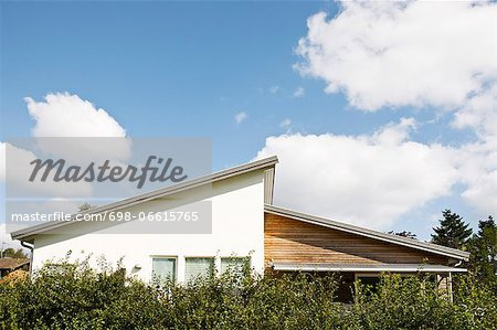 House against cloudy sky Stock Photo - Premium Royalty-Free, Image code: 698-06615765