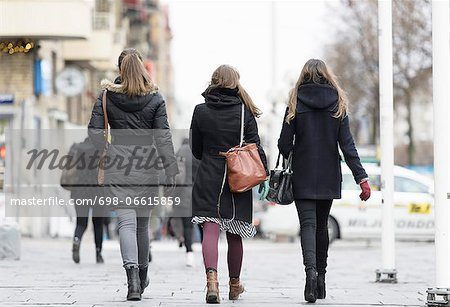 Rear view of women walking on street Stock Photo - Premium Royalty-Free, Image code: 698-06615859