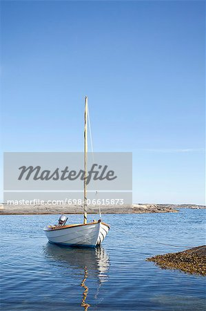 Nautical vessel moored in sea against sky Stock Photo - Premium Royalty-Free, Image code: 698-06615873