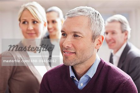 Business people looking away at office Stock Photo - Premium Royalty-Free, Image code: 698-06616062