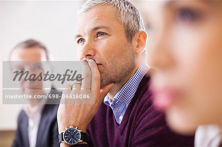 Mature businessman with colleagues in a meeting Stock Photo - Premium Royalty-Free, Image code: 698-06616086