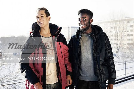 Young male friends looking away in winter Stock Photo - Premium Royalty-Free, Image code: 698-06616239