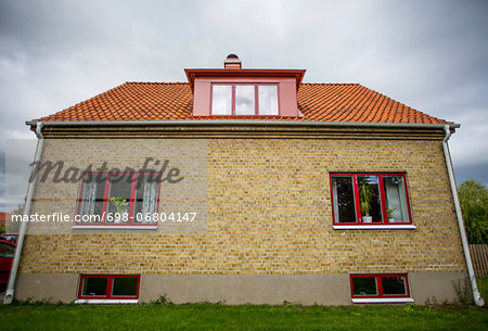 Exterior of house against cloudy sky Stock Photo - Premium Royalty-Free, Image code: 698-06804147