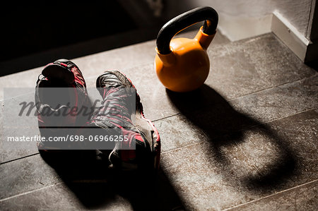 High angle view of kettlebell and sports shoes on table Stock Photo - Premium Royalty-Free, Image code: 698-06966255
