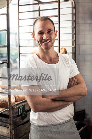Portrait of confident male owner standing arms crossed in bakery Stock Photo - Premium Royalty-Free, Image code: 698-06966432