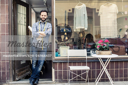Portrait of confident mid adult male designer standing at studio entrance Stock Photo - Premium Royalty-Free, Image code: 698-06966437
