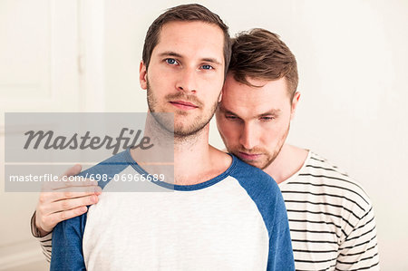 Portrait of young gay man with loving partner at home Stock Photo - Premium Royalty-Free, Image code: 698-06966689