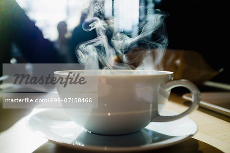 Coffee cup with steam coming out Stock Photo - Premium Royalty-Free, Image code: 698-07158466