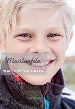 Close-up portrait of boy smiling Stock Photo - Premium Royalty-Free, Image code: 698-07158551