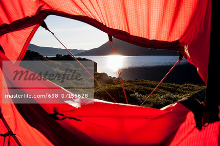 View of sunlight reflecting on lake through tent Stock Photo - Premium Royalty-Free, Image code: 698-07158628