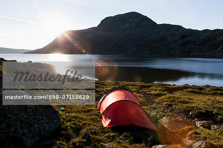 Tent at lakeshore against mountains Stock Photo - Premium Royalty-Free, Image code: 698-07158629