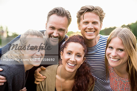 Portrait of happy friends outdoors Stock Photo - Premium Royalty-Free, Image code: 698-07158692