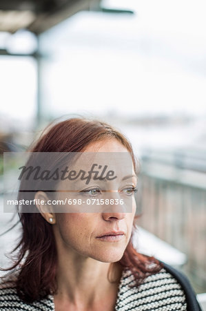 Pensive mature businesswoman looking away Stock Photo - Premium Royalty-Free, Image code: 698-07158836