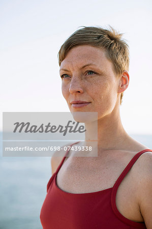 Thoughtful woman in spaghetti straps looking away against sea Stock Photo - Premium Royalty-Free, Image code: 698-07439338