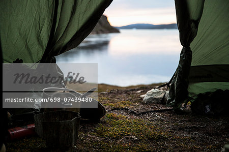 Kitchen utensil in tent at lakeshore Stock Photo - Premium Royalty-Free, Image code: 698-07439480