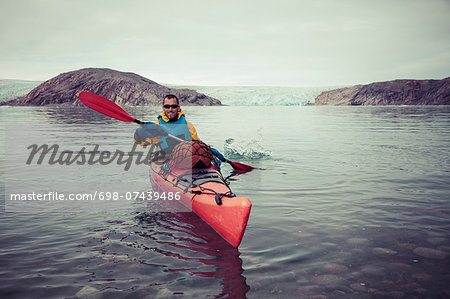 Portrait of happy mature man kayaking on sea Stock Photo - Premium Royalty-Free, Image code: 698-07439486