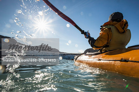 Rear view of mature woman kayaking on sea Stock Photo - Premium Royalty-Free, Image code: 698-07439493