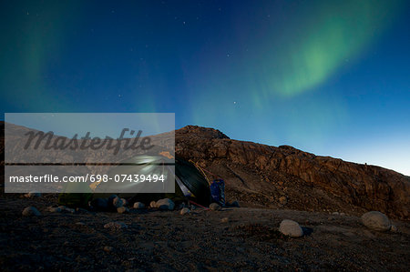 Tent with northern green lights at night Stock Photo - Premium Royalty-Free, Image code: 698-07439494