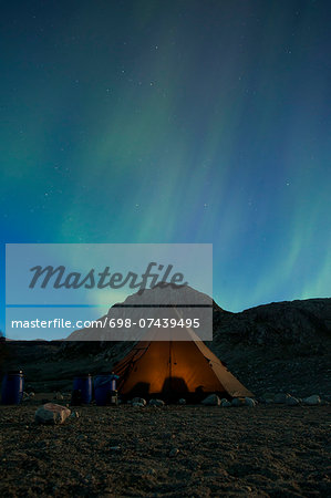 Northern lights or Aurora Borealis over tent at night Stock Photo - Premium Royalty-Free, Image code: 698-07439495