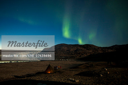 Northern green lights or Aurora Borealis over tent at night Stock Photo - Premium Royalty-Free, Image code: 698-07439496