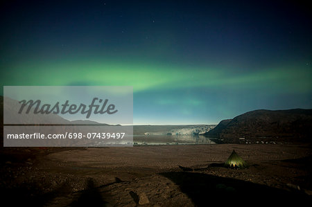 Northern green lights or Aurora Borealis over tent Stock Photo - Premium Royalty-Free, Image code: 698-07439497