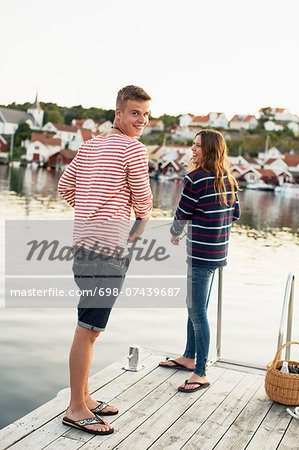 Rear view portrait of man with woman fishing on pier at lake Stock Photo - Premium Royalty-Free, Image code: 698-07439687