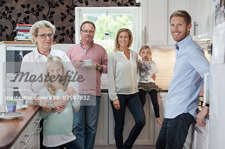 Portrait of happy multi-generation family in kitchen Stock Photo - Premium Royalty-Free, Image code: 698-07587832