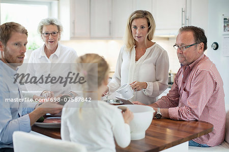 Family preparing food together in kitchen Stock Photo - Premium Royalty-Free, Image code: 698-07587842