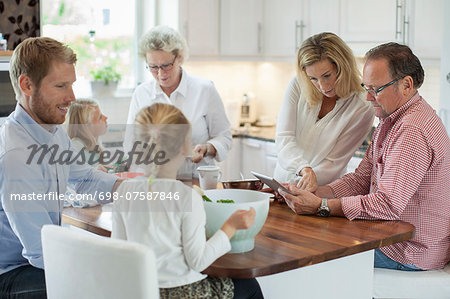 Three generation family preparing food in kitchen