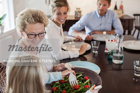 Multi-generation family having lunch at dining table Stock Photo - Premium Royalty-Free, Image code: 698-07587851