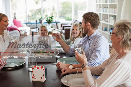 Multi-generation family having lunch together Stock Photo - Premium Royalty-Free, Image code: 698-07587853