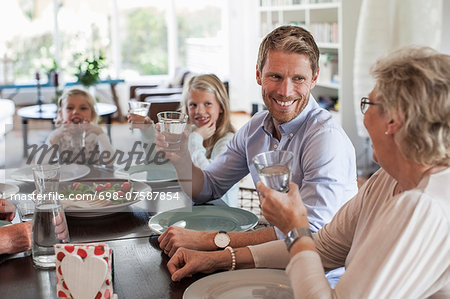 Happy family having lunch together at home Stock Photo - Premium Royalty-Free, Image code: 698-07587854