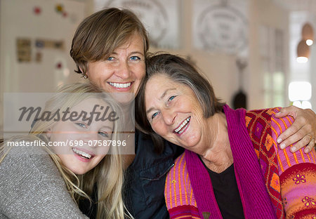 Portrait of happy three generation females at home Stock Photo - Premium Royalty-Free, Image code: 698-07587896