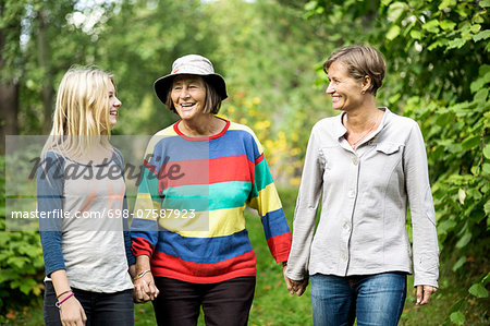Happy three generation females at park Stock Photo - Premium Royalty-Free, Image code: 698-07587923